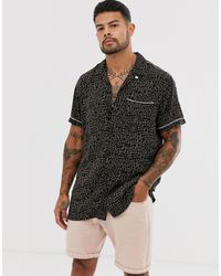 Jack & Jones Premium - Chemise à manches courtes avec col à revers et imprimé animal - Noir