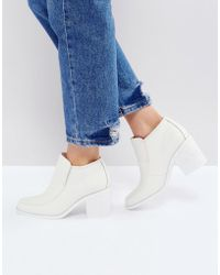 INTENTIONALLY ______ - Henry White Ankle Boots - Lyst