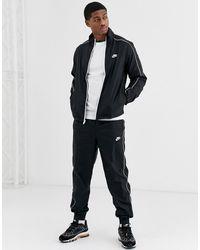 Nike – Gewebter Trainingsanzug - Schwarz