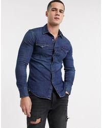 Levi's – Barstow – Schmales Western-Hemd aus Denim mit Stretch-Anteil - Blau