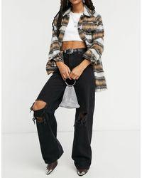 Bershka Jean large déchiré aux genoux style années 90 - Noir