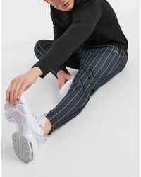 ASOS 4505 Skinny Fit Training jogger With Pinstripe - Black