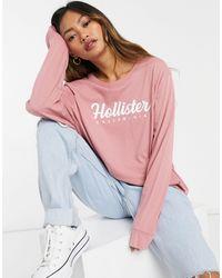Hollister T-shirt à manches longues avec logo sur le devant - Rose - Bleu