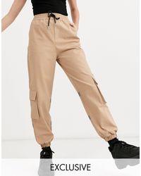 Collusion Pantalones con panel reflectante - Neutro