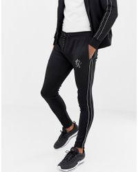 0f3e5e3675 Gym King - Pantalon de jogging ajust avec bandes latrales - Lyst