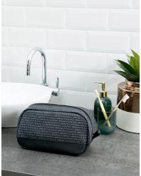 Armani Exchange All Over Logo Wash Bag In Black