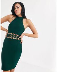 The Girlcode Robe moulante style bandage avec croisillons - Vert