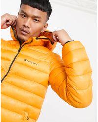 Champion Cappotto imbottito con cappuccio arancione mimetico - Multicolore