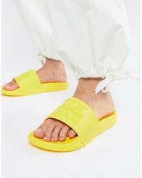 Calvin Klein - Christie Yellow Jelly Sliders - Lyst