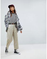Carhartt WIP Pantalon chino large et court style décontracté - Neutre