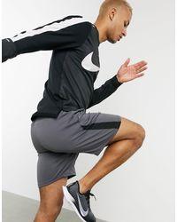 Nike Element - Top con zip corta nero
