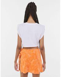 Bershka Оранжевая Мини-юбка Из Махровой Ткани С Запахом И Цветочным Принтом От Комплекта -оранжевый Цвет