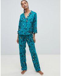 ASOS - Pigiama tradizionale con pantaloni in 100% modal con stampa leopardata - Lyst