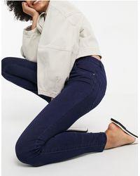 ONLY – Mittelhohe Jeans mit engem Schnitt - Blau
