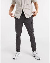 ASOS Pantalones cargo ajustados en negro desgastado