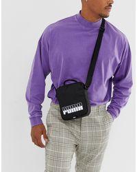 PUMA Mini Portable Ii Black Bag