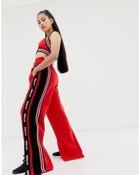 Ivy Park Spliced Stripe Crop Joggers In Red