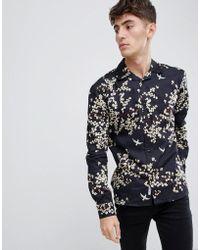 Bellfield Camisa con cuello de solapa y estampado de flores - Negro