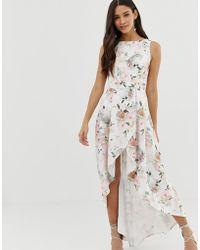 Chi Chi London - Midi-jurk Met Overslagrok, Ongelijke Zoom En Bloemenprint - Lyst