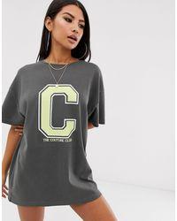 The Couture Club Vestido estilo camiseta extragrande - Negro
