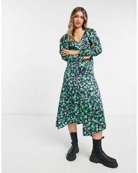 TOPSHOP Vestido midi verde con estampado floral