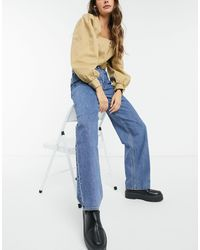 Weekday – Rail – Jeans aus Bio-Baumwolle im Stil der 90er mit hohem Bund und geradem Bein - Blau