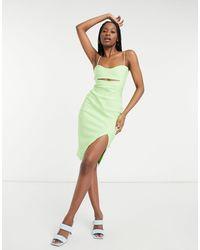 Vesper Vestido corto ajustado verde claro con abertura en el muslo y en la parte delantera