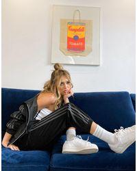 adidas Originals Comfy Cords - Joggers di velluto a coste con fondo elasticizzato neri - Nero
