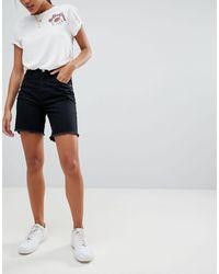 Missguided Pantaloncini lunghi di jeans - Nero