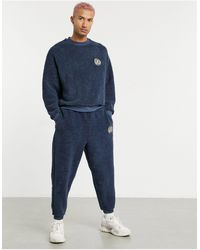 ASOS Co-ord Oversized Teddy Borg joggers With Crest Embroidery - Blue