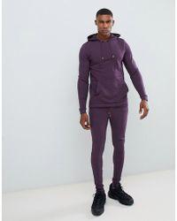 ASOS Survêtement avec hoodie moulant et pantalon de jogging ultra ajusté - Violet foncé