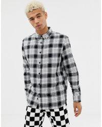 on sale bd28a 53a56 Camicia a quadri nera e bianca con colletto button-down - Nero