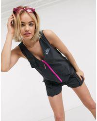 Nike – Kurzer Utility-Jumpsuit - Blau