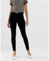 River Island Molly Velvet Skinny Jeans In Black