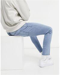 Burton Jeans slim lavaggio blu slavato
