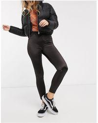 Monki Pantalones ajustados s efecto mojado - Negro