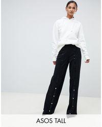 ASOS ASOS DESIGN Tall - Pantaloni semplici con fondo ampio e bottoni a pressione - Nero
