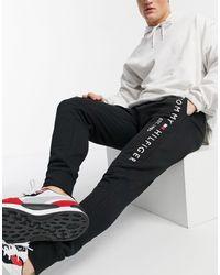Tommy Hilfiger - Joggers neri con logo ricamato e fondo elasticizzato - Lyst
