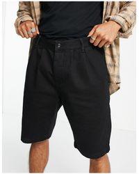 TOPMAN Shorts vaqueros negros con pinzas en la parte delantera