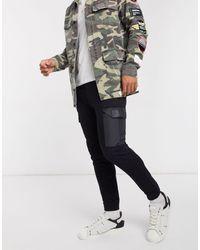 The Couture Club Joggers negros cargo tapered con bolsillos en contraste