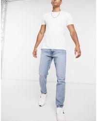 Tommy Hilfiger Tommy Hilfger Athletic Slim Tapered Jeans Mid Wash - Blue