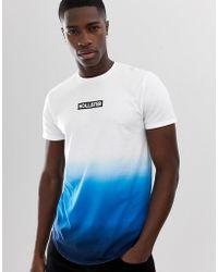 bf9bc8f8187ff Hollister T-Shirt mit Farbverlauf in Weiß bis Marineblau, Logoprint auf der  Brust und