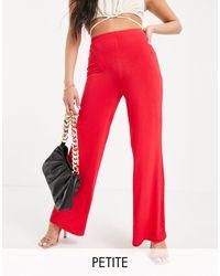 Flounce London Pantaloni basic a vita alta con fondo ampio rossi - Rosso