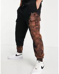 Karlkani Joggers cargo s con efecto descolorido y logo - Negro