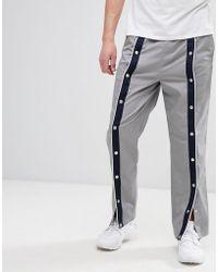 ASOS Pantalones holgados en gris con botones de presión en la parte delantera
