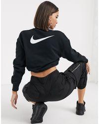Nike – Kurzes Sweatshirt mit elastischem Kordelzug und kleinem Swoosh-Logo - Schwarz