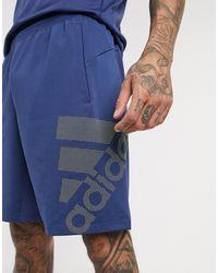 adidas Originals Adidas – Marineblaue Trainingshorts mit Logo