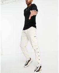 TOPMAN Pantalon cargo à logo signature - cassé - Blanc