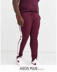 ASOS Joggers ajustados con raya lateral en burdeos - Rojo