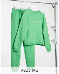 ASOS Asos Design Tall - Trainingspak Met Sweater Met 'be Kind'-borduursel / joggingbroek Met Rechte Pijpen En Print - Groen